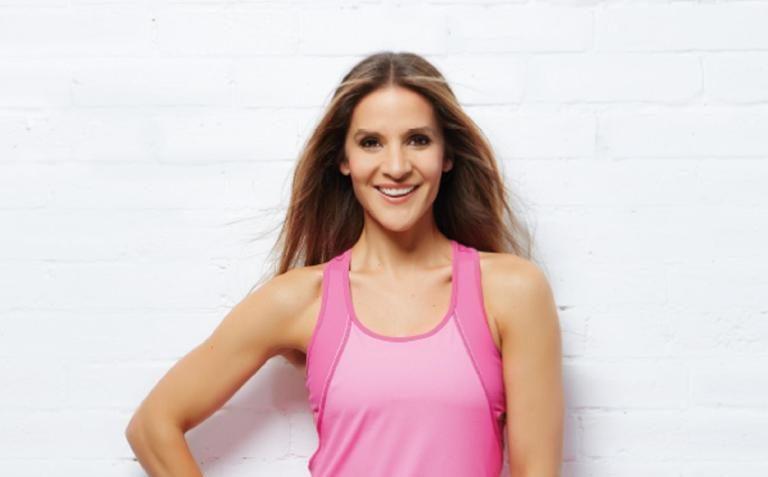 Amanda Byram posing in fitness gear