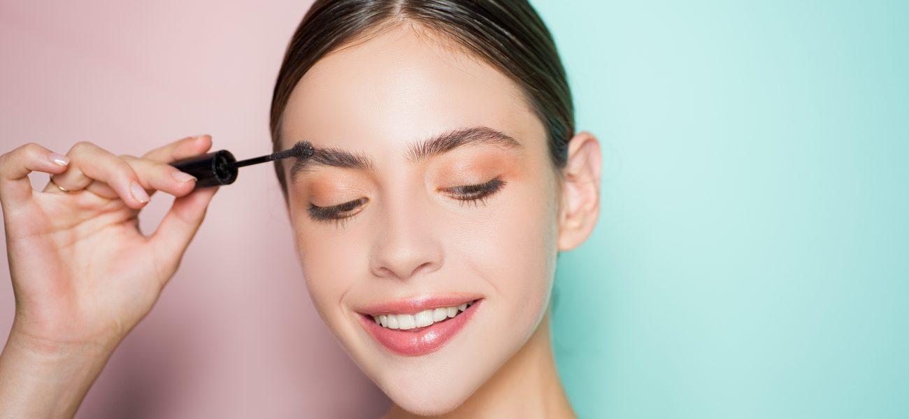 Woman-applying-eyebrow-gel