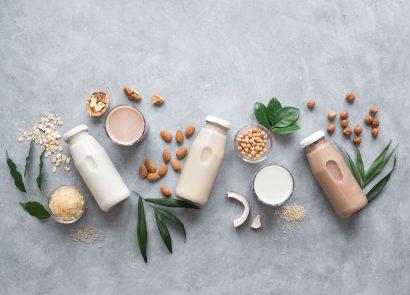 dairy-free milk bottles on grey background