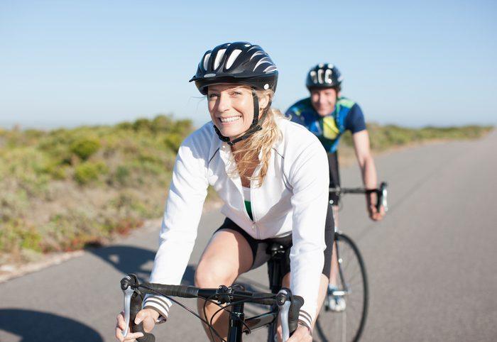 woman cycling in sun