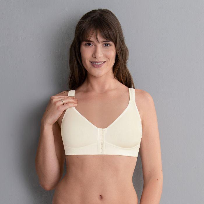 model on grey background wearing cream mastectomy bra